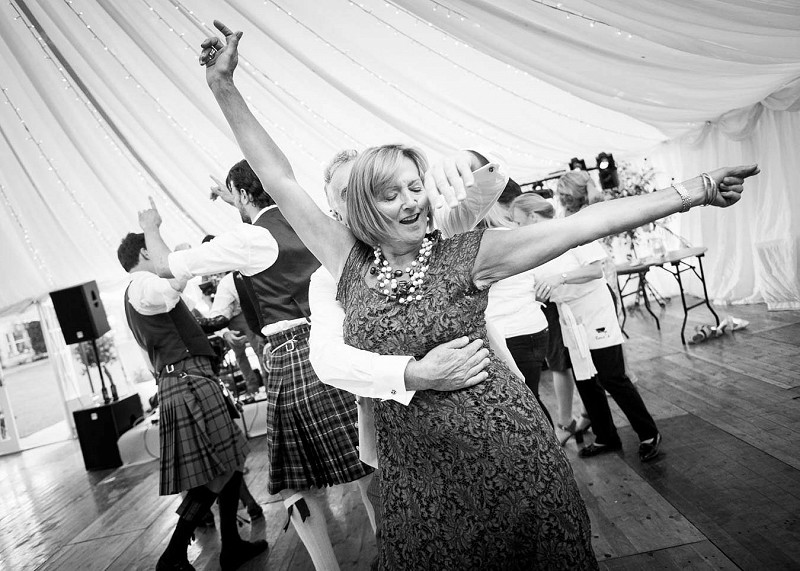 A woman dancing at a wedding